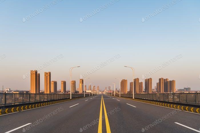 empty road on downhill approach bridge