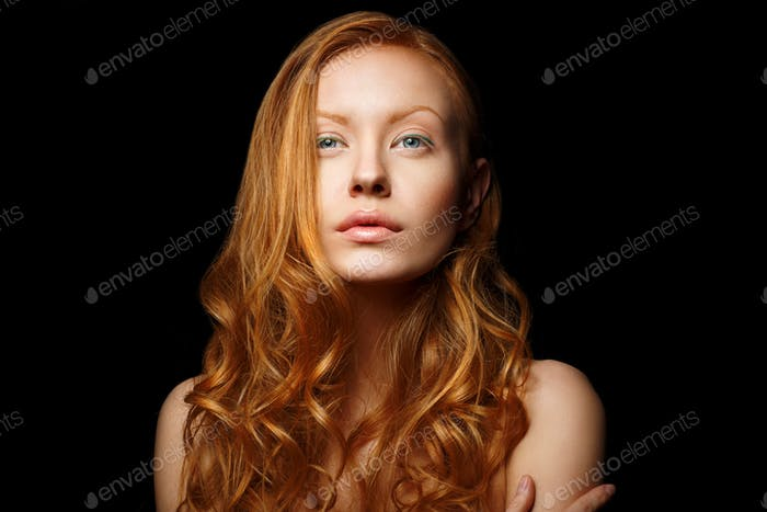 Pure Beauty. Sensual Woman with Flowing Red Hair