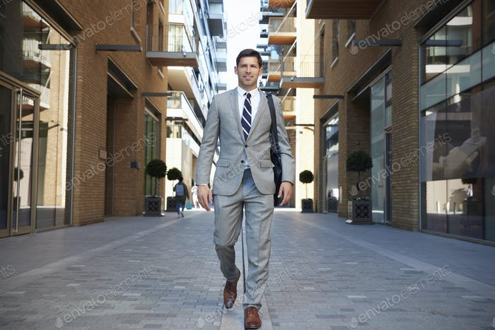 Businessman Walking to Work Along City Street