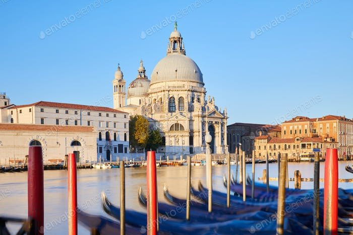 Venice, Saint Mary of Health basilica and moored gondolas in the morning