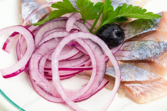 Delicious salted herring with sliced red onion.