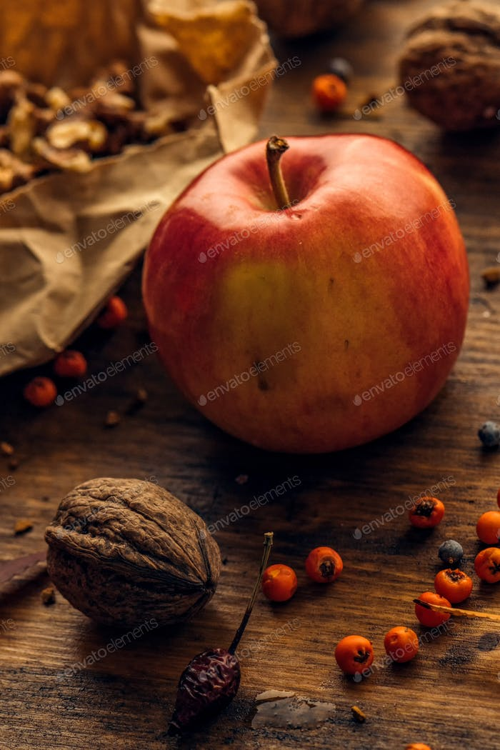 Tasty red apple and walnut fruit