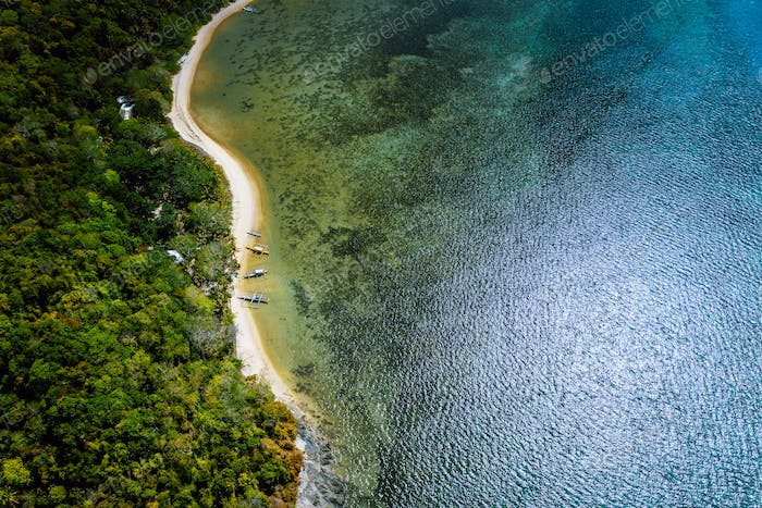 Palawan, Philippines, El Nido. Aerial drone above view of a secluded deserted tropical beach with