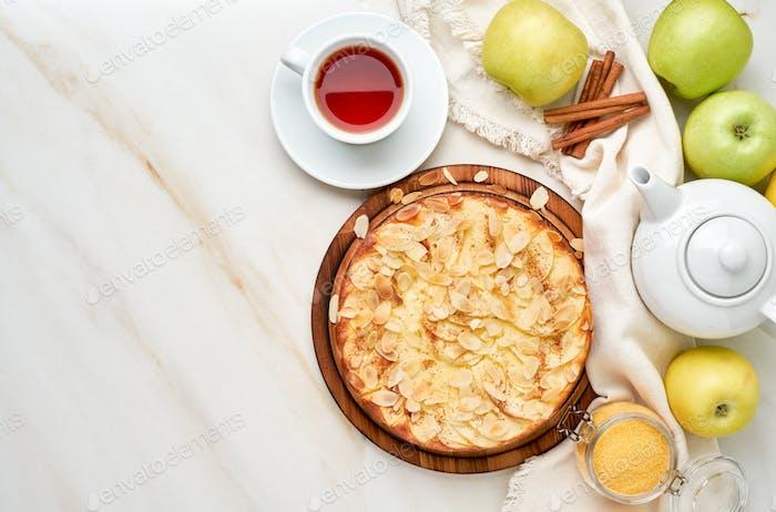 Cheesecake, apple pie, curd dessert with polenta, apples, almond flakes