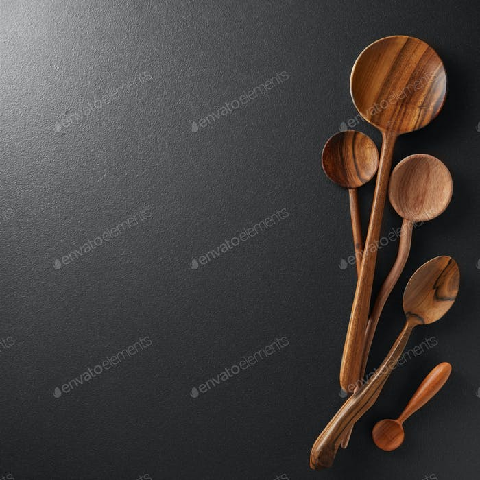 Wood spoons on black board background