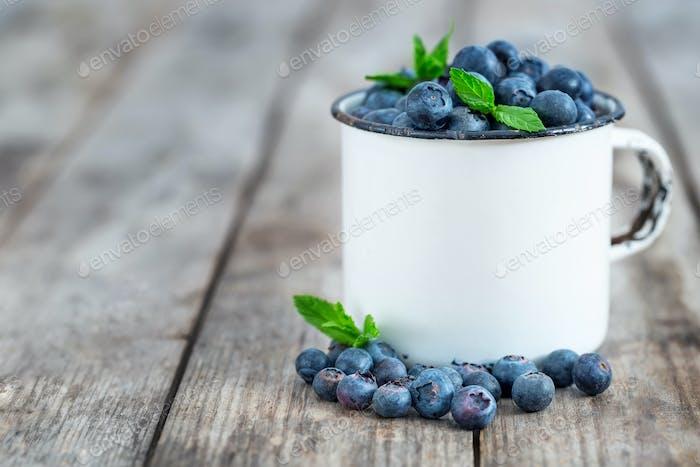 Blueberry in mug background