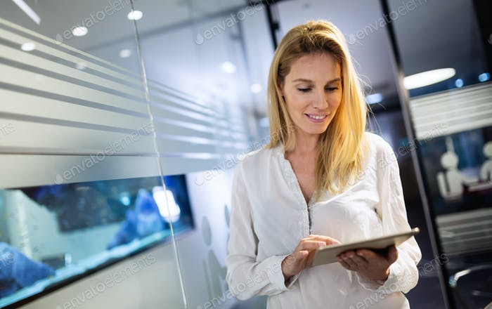 Businesswoman using tablet at information technology office