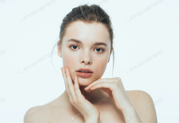 Woman beauty face with hand portrait isolated on white with healthy skin