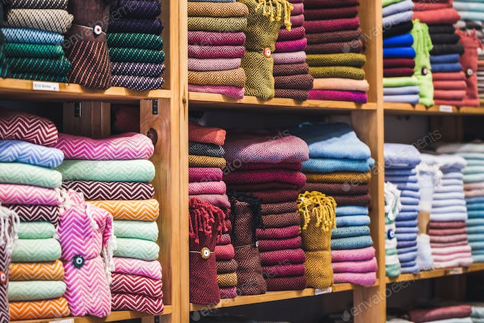 Store tissue. Big shelf with a colorful towels