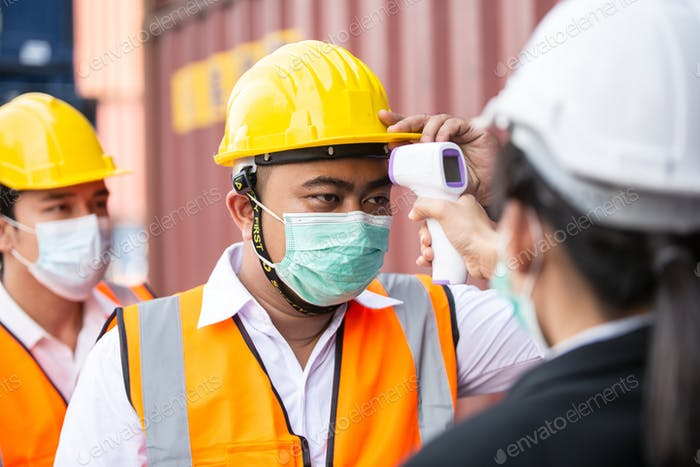 Female worker scanning fever temperature with digital thermometer