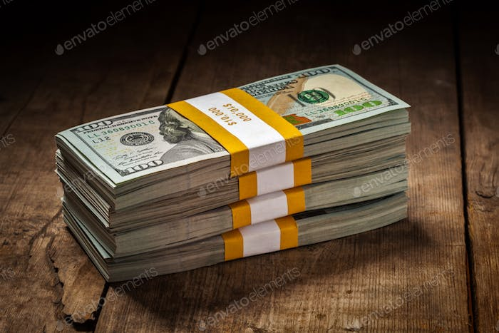 Stacks of new 100 US dollars 2013 banknotes