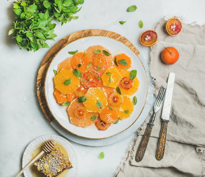 Fresh mixed citrus fruit salad with mint and honey