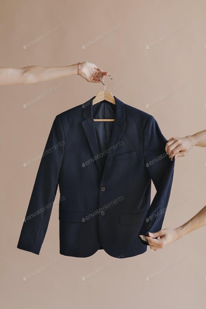 Black blazer on a hanger