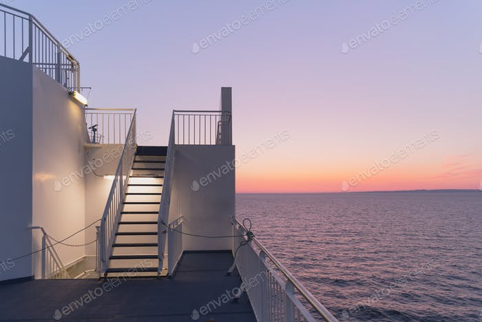 Deck of a cruise ship during sunset