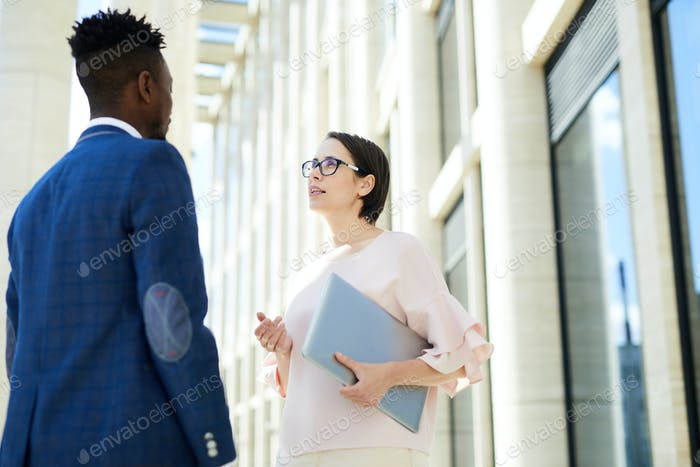 Confident lady communicating with colleague