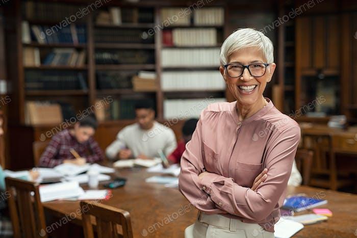 Smiling university professor in library