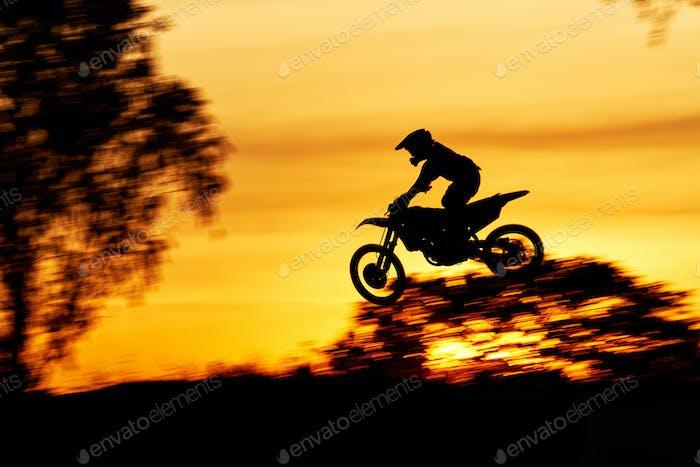 Silhouette scene of the jumping motocross