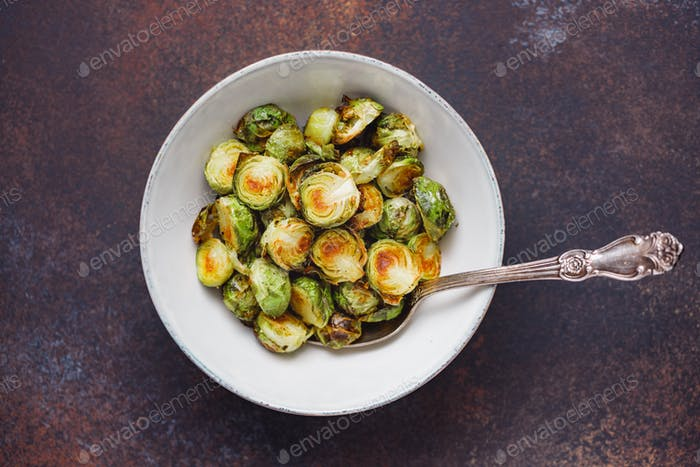 Top view of a ceramic bowl with roasted brussel sprouts