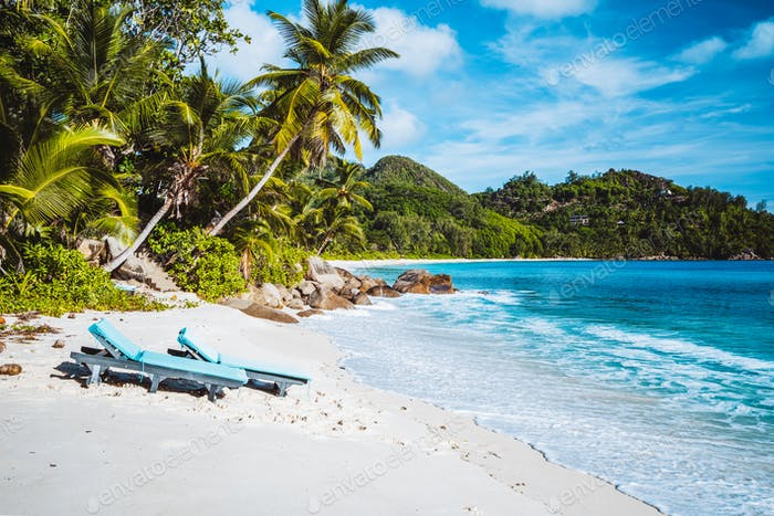 Mahe, Seychelles. Beautiful Anse intendance, tropical beach with relaxing lounger. Blue ocean, sandy