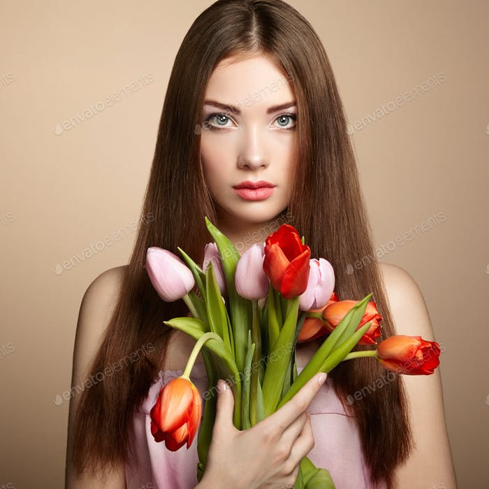 Portrait of beautiful dark-haired woman with flowers