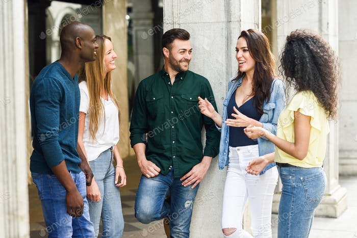 Multi-ethnic group of friends having fun together in urban backg