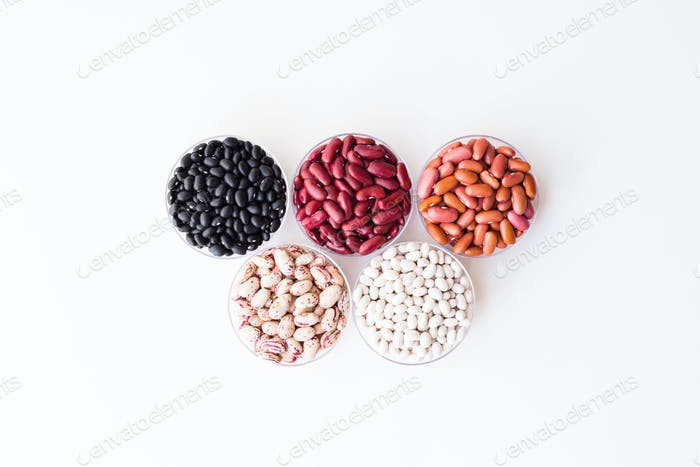 Different varieties of beans in round plates. Olympic rings.