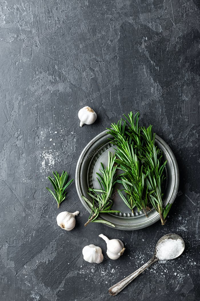Rosemary, garlic, salt and white pepper, culinary background with various spices, directly above
