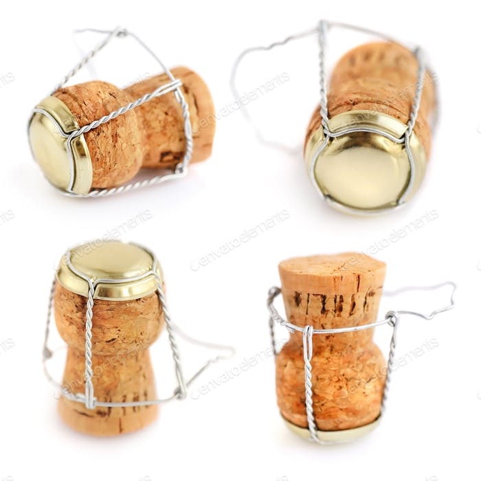 Corks from champagne bottle isolated on the white background