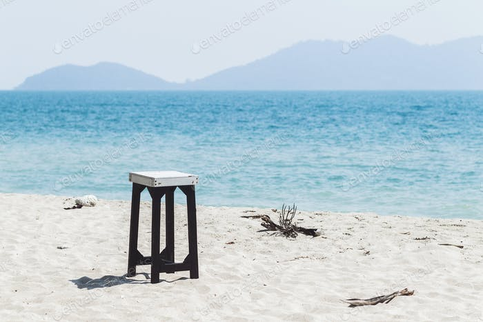 Beach furniture on white sand