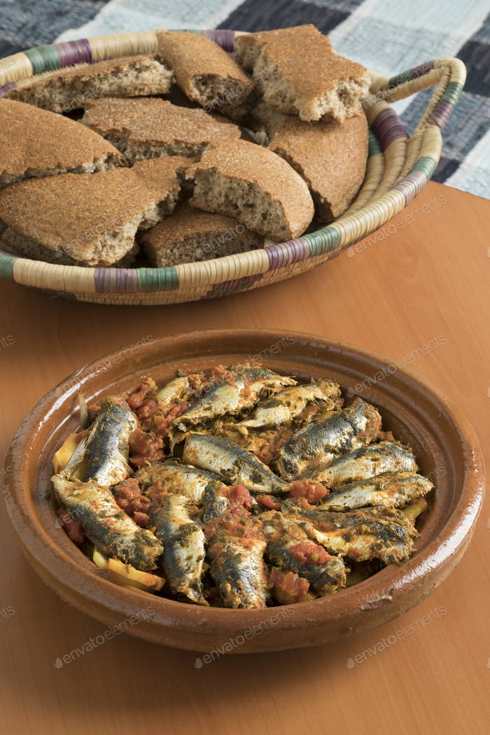 Traditional  Moroccan Tagine with sardines and vegetables