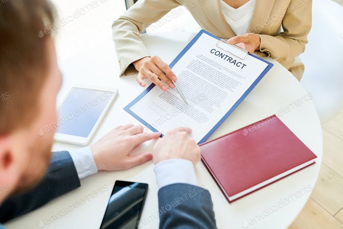 Businesswoman Showing Contract to Client Close Up