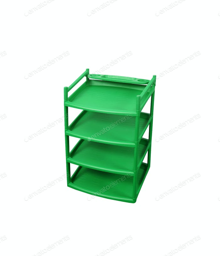 Green plastic shelves isolated on white