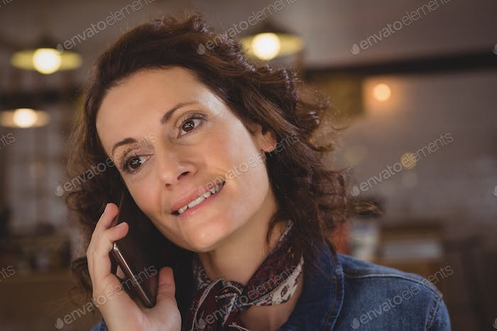 Businesswoman looking away while talking on phone