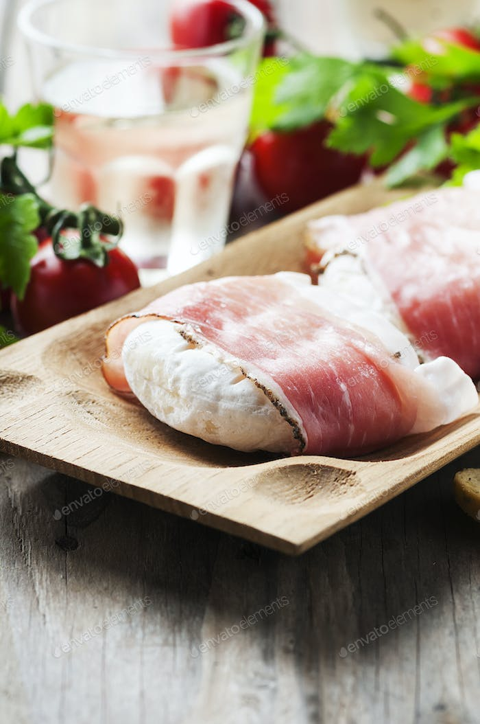 Traditional italian cheese tomino with bacon