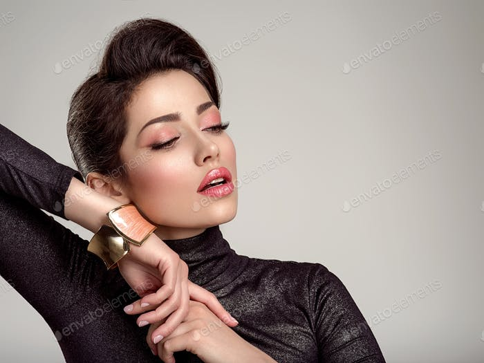 Beautiful  fashion woman with living coral lipstick. Attractive white girl wears luxury jewelry.
