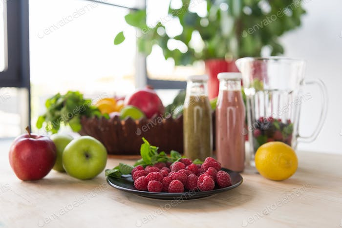 close up view of detox drinks and healthy food on table