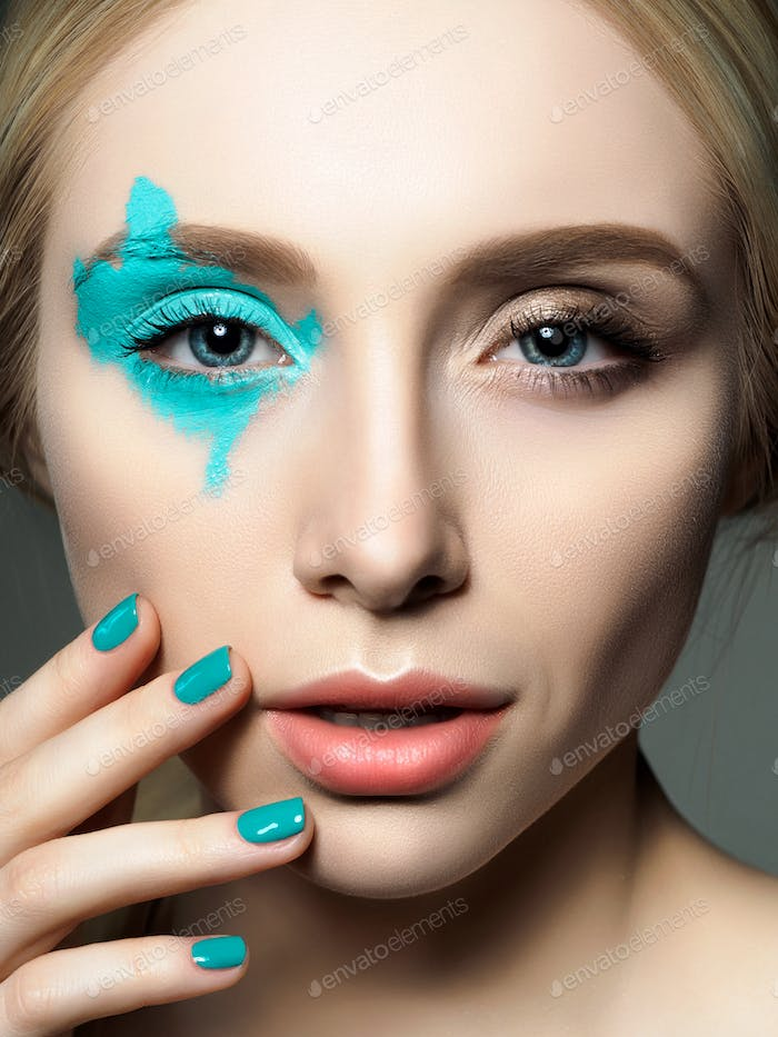 Portrait of young beautiful woman with fashion make up