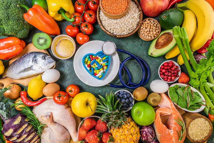 Background of healthy food. Fresh fruits, vegetables, meat and fish on table. Food to boost immunity