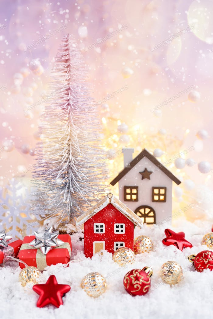 Christmas composition with decorative huts, gifts and festive decorations
