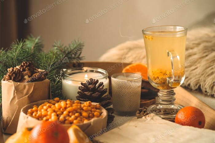 Still life with orange and sea buckthorn