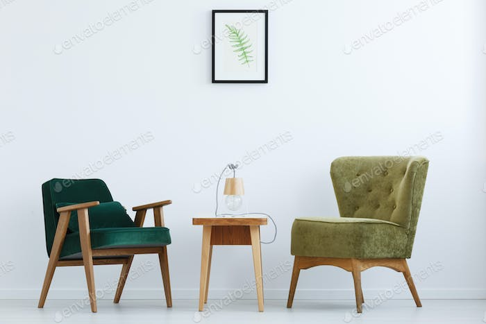 Ascetic interior with green chairs