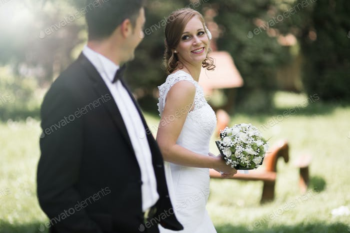 Bride and groom outdoor smiling
