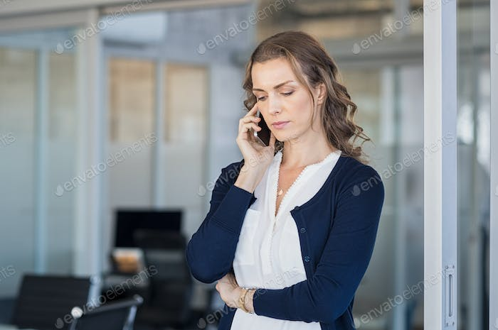 Serious businesswoman talking on phone