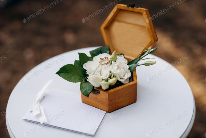 gold wedding rings with a wedding decor