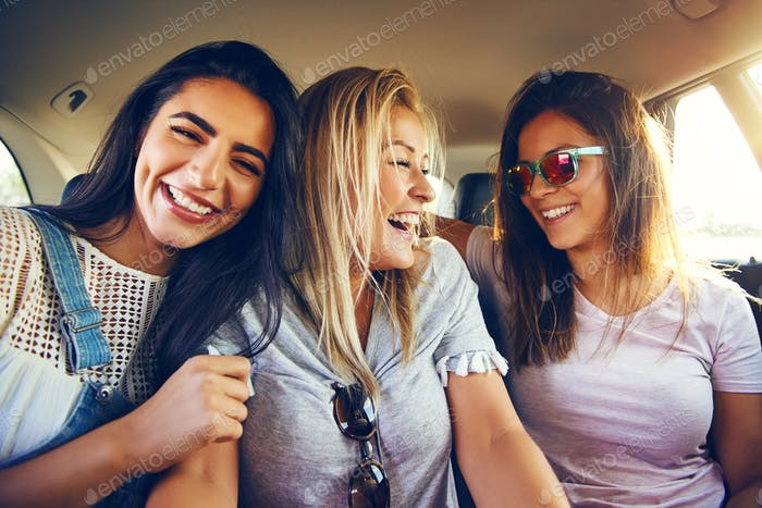 Laughing affectionate female friends