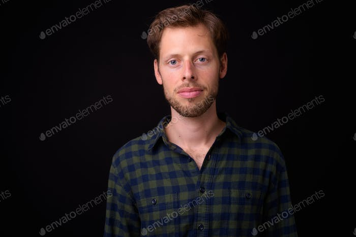 Face of bearded hipster man looking at camera