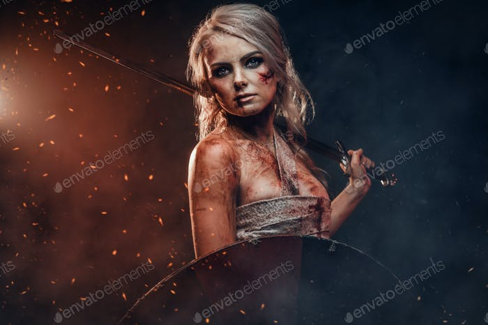 Fantasy woman warrior wearing rag cloth stained with blood and mud, holding sword and shield
