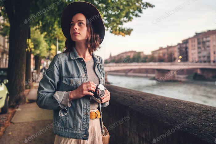 Attractive girl with a camera in Italy