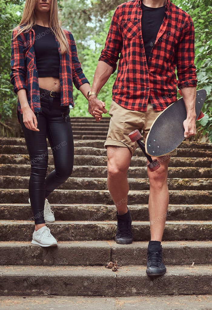 Young hipster couple in a park