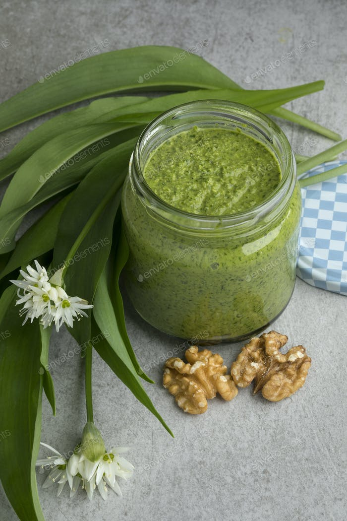 Homemade ramsoms pesto with flowers and walnuts